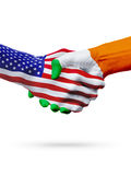 Flags United States and Ireland countries, partnership handshake. Stock Images