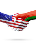 Flags United States and Madagascar countries, partnership handshake. Stock Photography
