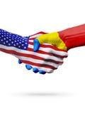 Flags United States and Moldova countries, partnership handshake. Royalty Free Stock Photos