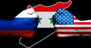 Flags of the United States and Russia painted on two clenched fists facing each other with outline map of Syria on black backgroun. D/concept of complex civil Royalty Free Stock Photos