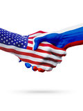 Flags of United States and Russian Federation countries handshake. Royalty Free Stock Images