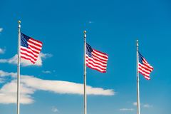 Flags of the United States. Waving over blue sky in Washington DC Royalty Free Stock Photo
