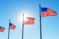 Flags of the United States. Waving over blue sky in Washington DC Royalty Free Stock Photography