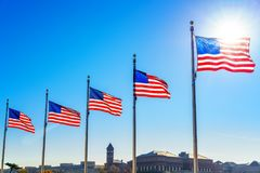 Flags of the United States. Waving over blue sky in Washington DC Stock Photography