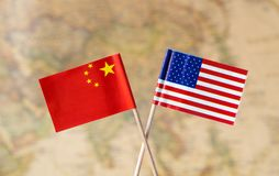 Flags of the USA and China over the world map, political leader countries concept image stock photo