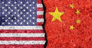 Flags of USA and China painted on cracked wall background/USA-China trade war concept.  Stock Images