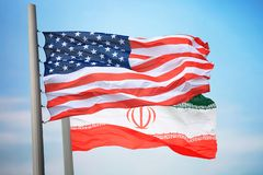 Flags of the USA and Iran royalty free stock photo