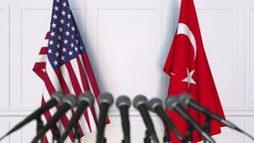 Flags of the USA and Turkey at international meeting or negotiations press conference. 3D animation stock video footage