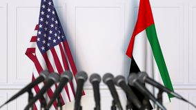 Flags of the USA and the UAE at international meeting or negotiations press conference. 3D animation stock video