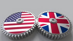 Flags of the USA and The United Kingdom on meshing gears. International cooperation conceptual animation. Flags of the USA and The United Kingdom on meshing stock video footage