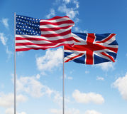 Flags of usa and United Kingdom. Two flags of usa and United Kingdom  on a sky background Royalty Free Stock Photo