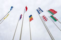 Flags of various European countries. Against the background of the cloudy sky stock images