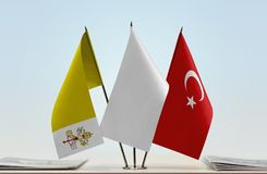 Flags of Vatican City and Turkey with a white flag in the middleUnited Kingdom of Great Britain. Desktop flags of Vatican City and Turkey with a white flag in royalty free stock images