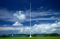 Flags at Waitangi. The flag pole at Waitangi showing the first New Zealand colonial flag (left), the current New Zealand flag (top) and the British flag (right stock images