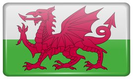 Flags Wales in the form of a magnet on refrigerator with reflections light. Flags of Wales in the form of a magnet on refrigerator with reflections light Stock Images