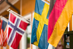 Flags on wall of building in Sigtuna, Sweden. Stock Images