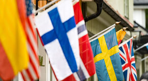 Flags on wall of building in Sigtuna, Sweden. Stock Photography