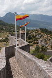 Flags on the wall of citadel. Stock Images