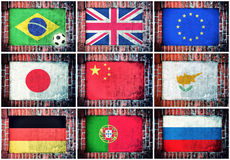 Flags in wall. International flags in the old brick wall Royalty Free Stock Photos