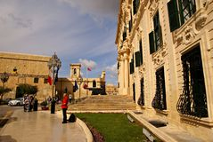 Flags waving on the building of Palace  of the Prime Minister in Valletta Royalty Free Stock Image