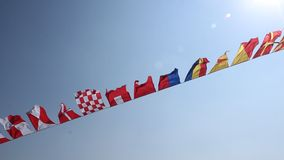 Flags waving stock video footage