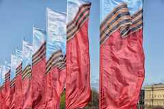 flags waving in the wind Stock Photos