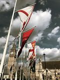 Flags at Westminster. Flags flying outside Westminster in London, UK on the Queens Birthday 2017 stock photography