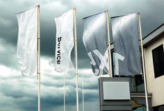 Flags on the wind. Four flags on the wind with dramatic sky background royalty free stock photography