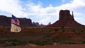 Flags on the wind against the scenic view in the Monument Valley. Arizona, Utah, USA. Navajo Tribal Park stock video