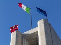 Flags in the wind. Flags flaunt  on a monument Stock Photo