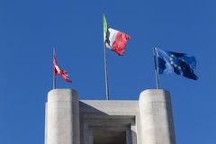 Flags in the wind. Flags flaunt  on a monument Stock Image