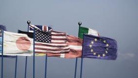 Flags wind mix JAP USA EU stock footage
