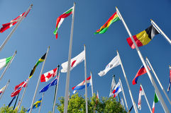 Flags of the world. International flags flutter in the breeze at Calgary's Canada Olympic Park Royalty Free Stock Image