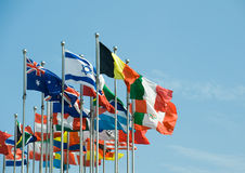 Flags of the world. Happily blowing in the wind stock photo