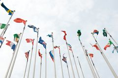 Flags of the world. Happily blowing in the wind Royalty Free Stock Photos
