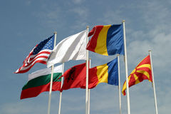 Flags of the world. Happily blowing in the wind Royalty Free Stock Photo