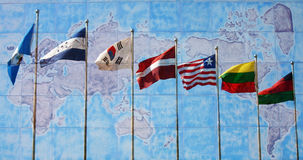 Flags of the World. With a map in the background Stock Image