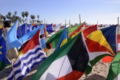 Flags of the world. Colorful flags of the world on the beach promoting world peace stock photo