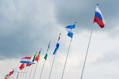 Flags of the world countries on the flagpole. Royalty Free Stock Photos