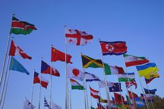 Flags of the world. Flying royalty free stock photo