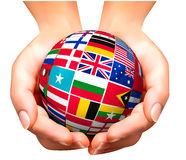 Flags of the world in globe and hand. Stock Photos