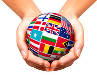 Flags of the world in globe and hands. Stock Photo