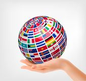 Flags of the world on a globe, held in hand. Vector illustration stock illustration
