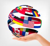 Flags of the world on a globe, held in hand. Vector illustration Stock Photo