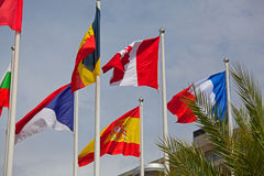 Flags of the world happily blowing in the wind Royalty Free Stock Photos