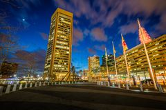 Flags and the World Trade Center at night, at the Inner Harbor, in Baltimore, Maryland royalty free stock photography
