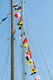 Flags on yachts mast. Many multicolors flags on yachts mast Stock Images