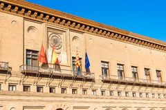 Flags of Zaragoza, Spain, Aragon and the European Union near the building of the City Hall of Zaragoza, Spain. Flags of Zaragoza, Spain, Aragon and the European royalty free stock photo