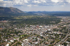 Flagstaff, Arizona. Freight train rolling through Flagstaff, Arizona as viewed from above Stock Images
