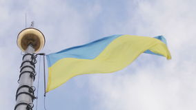 Flagstaff Ukrainian flag. Tapered flagpole at City Hall in Lviv with flag of Ukraine stock video footage